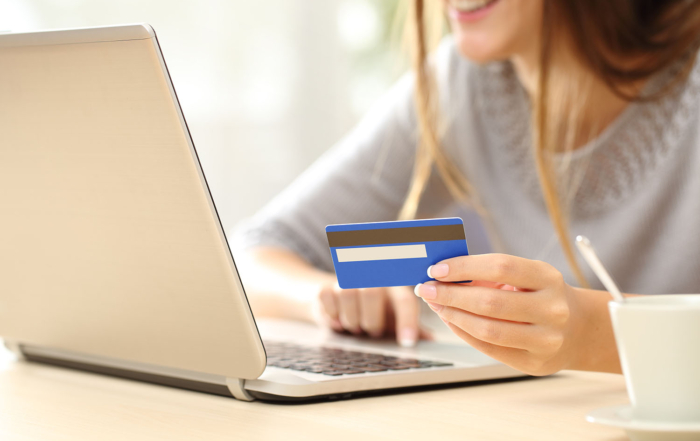 Woman buying online with credit card